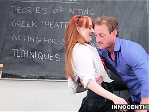 ginger-haired schoolgirl railing her educator