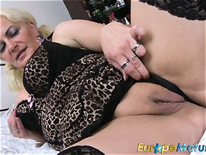 EuropeMaturE blonde gal is frolicking on the couch