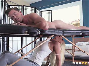 Nicolette Shea masturbates Kyle on the rubdown table