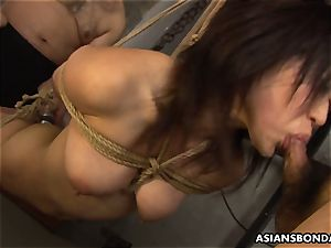 trussed up to a strap and deep throating on the fellas