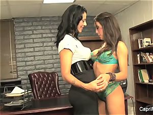 Brunettes Capri and Zoey are huge-titted office lesbians