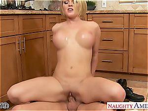 big-chested wife Krissy Lynn slurping cum in the kitchen