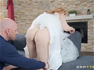 Redheaded Lauren Phillips bouncing on a huge wood
