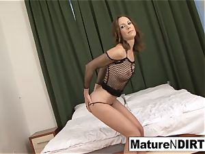 black-haired cougar drains before taking a big black cock