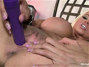 hot ash-blonde Nikita plays with a purple fucktoy